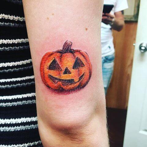 small jack o lantern tattoo idea for halloween