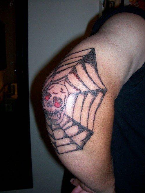 spider web elbow tattoo