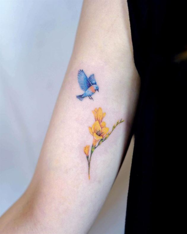 cute bird and yellow freesia flower tattoo