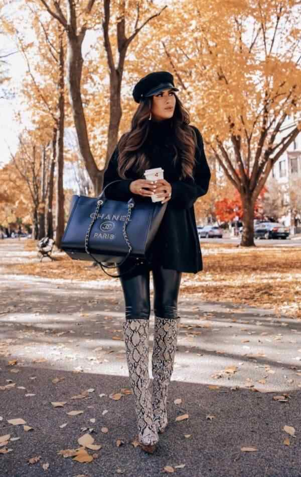black sweater and leather pants with winter snake printed boots