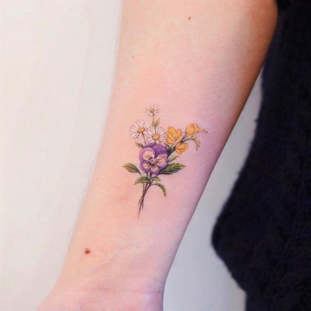 bouquet of yellow white and purple freesia flowers tattoo
