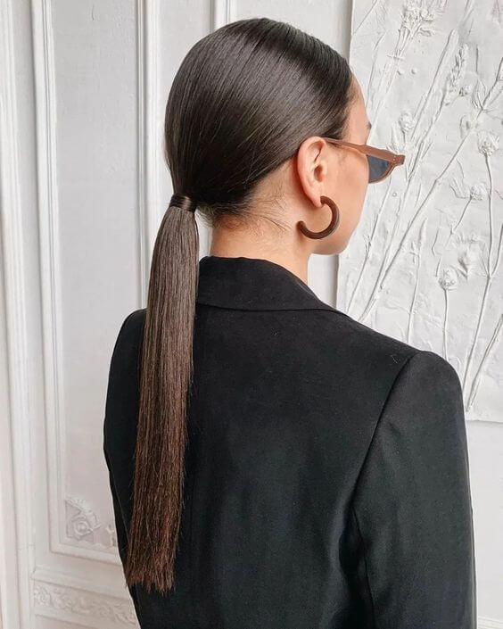 cute easy sleek low pony hairstyle for winter