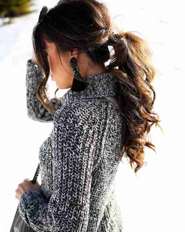 cute voluminous ponytail hairstyle for winter