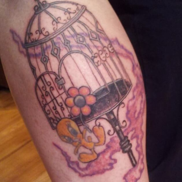 small tweety bird with cage and flower tattoo design