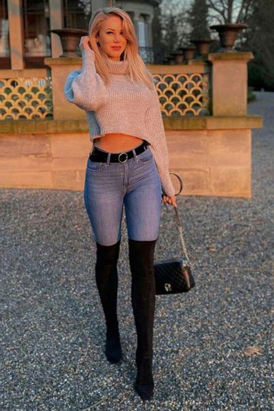 gey turtle neck cropped sweater with jeans and long black boots outfit
