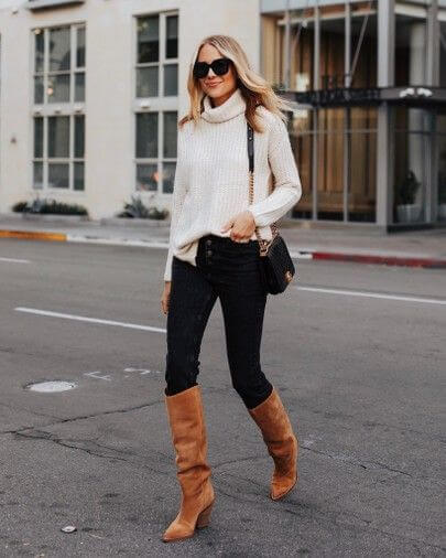 White sweater and jeans pant with classy brown knee length ankle boots outfit
