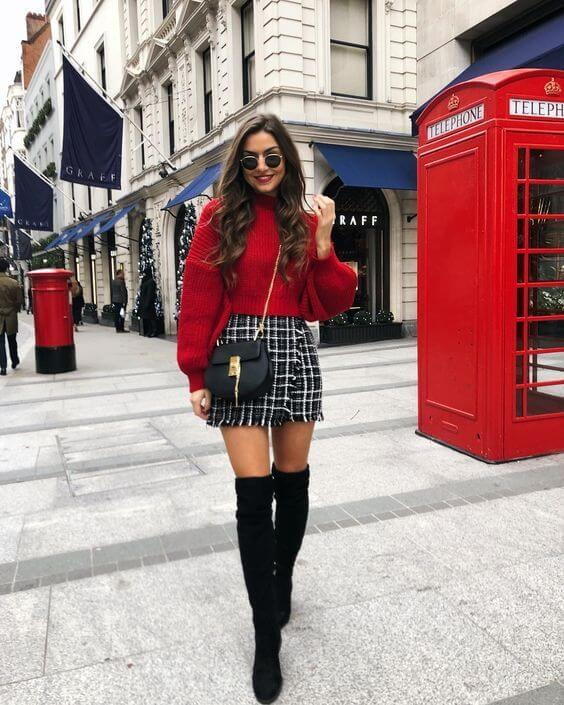 red sweater with short skirt and black knee length boots outfit