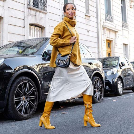 yellow turtle neck sweater and yellow winter boots street style