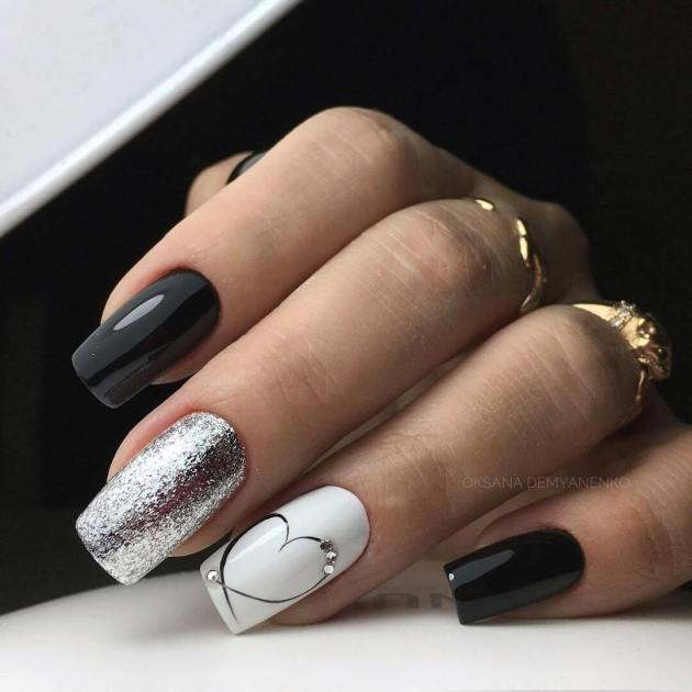 black and silver glitter with heart outlined nails