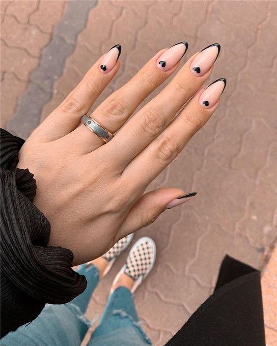 nude coffin small black heart manicure