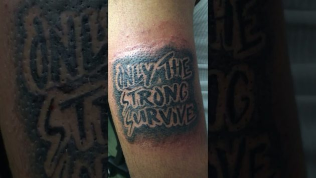 black ink only the strong survive tattoo design