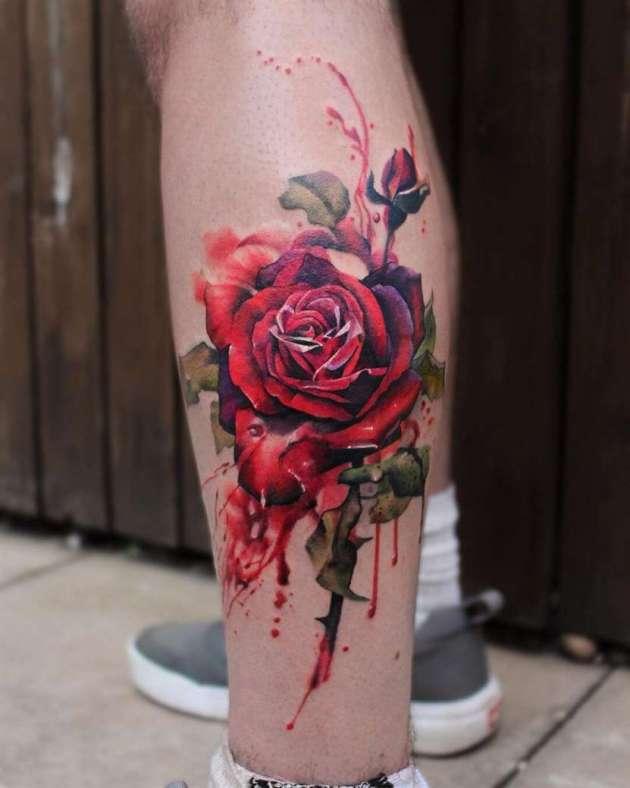 deep shades of red bleeding rose tattoo design on leg
