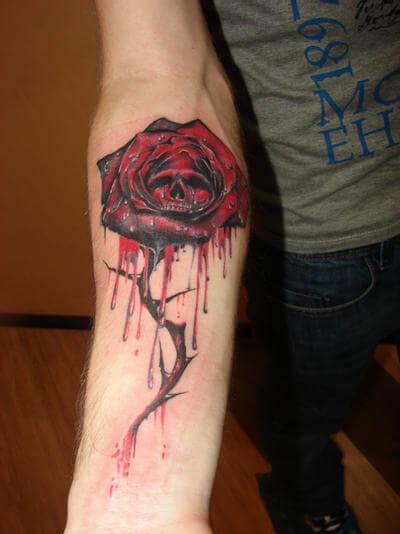 bleeding rose with skull tattoo design on forearm