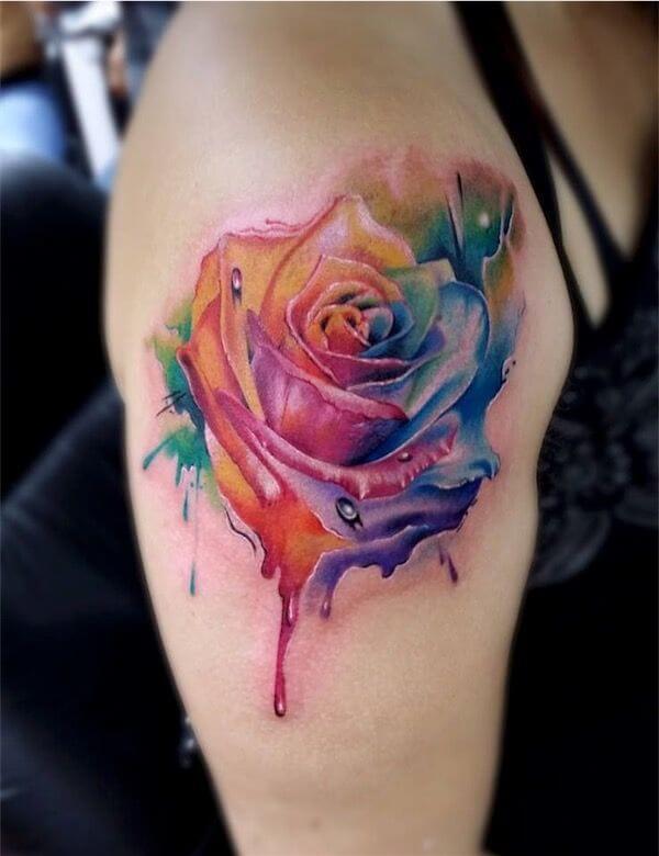 watercolor bleeding rose tattoo design on shoulder