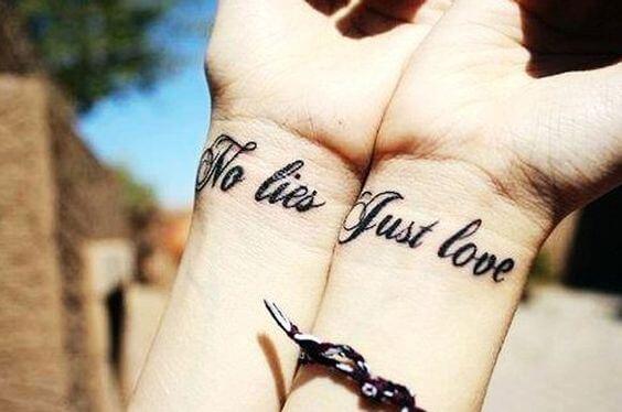 cute font no lies just love tattoo on wrists