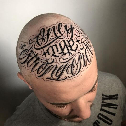 script lettering only the strong survive tattoo design on head