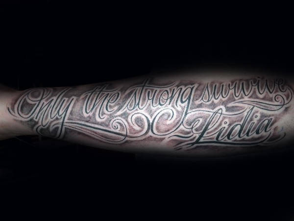 only the strong survive with name tattoo on side forearm