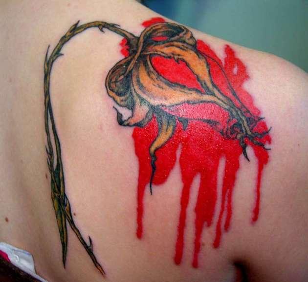 bleeding red rose bud tattoo on shoulder blade