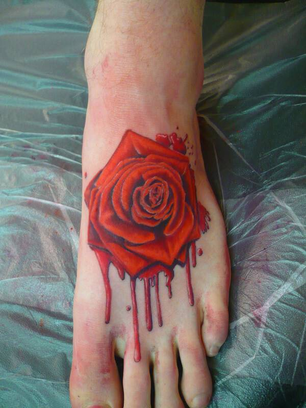 red rose bleeding in blood tattoo design on foot