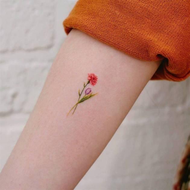 tiny blooming carnation January birth flower bud tattoo design