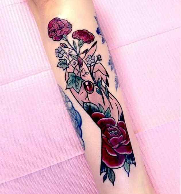 carnation January birth flowers tattoo with female hand
