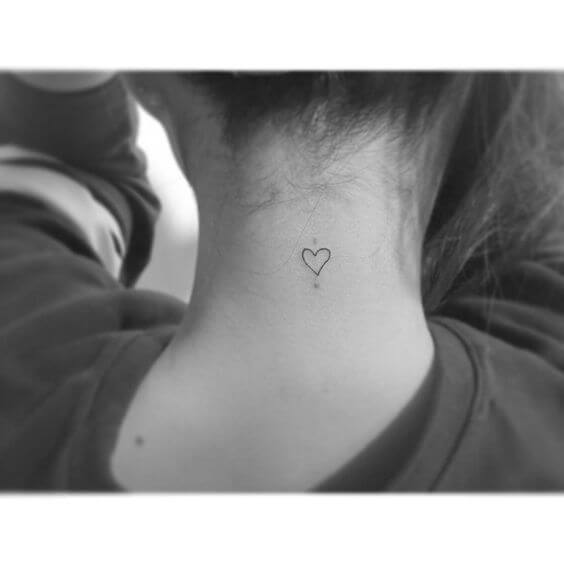 cute tiny outline heart tattoo idea on back for girls