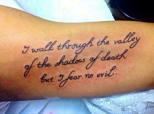 i fear no evil quote tattoo idea on side upper arm for men