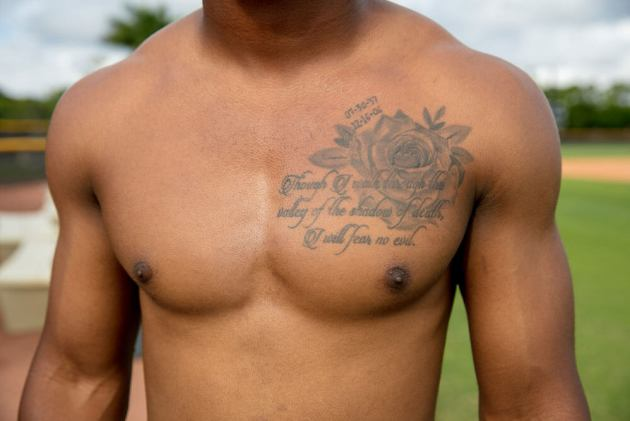 i will fear no evil quote with black rose tattoo design on men chest