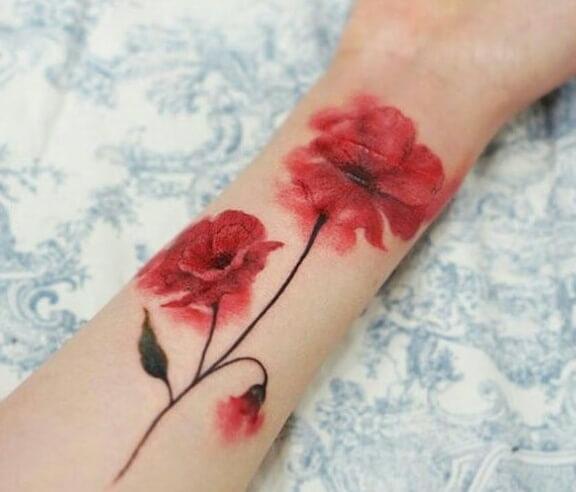 red colored carnation January birth flower with bud tattoo design on forearm