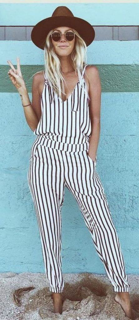 white striped romper with brown cowgirl hat outfit idea