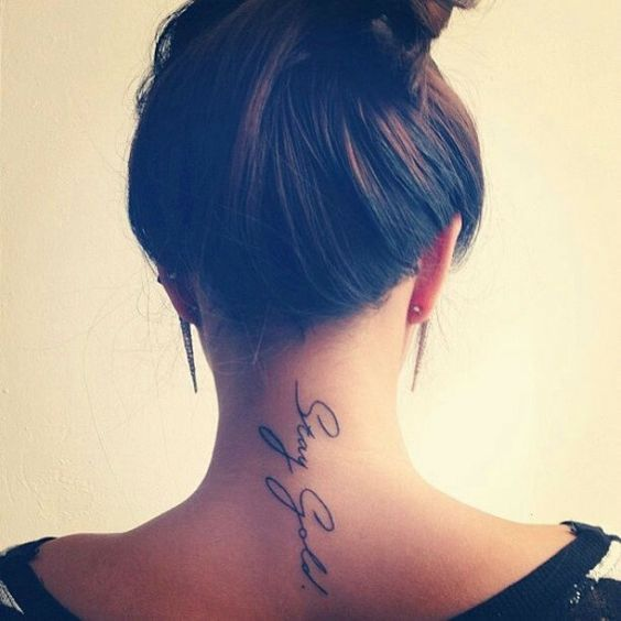 female inspiring quote stay gold tattoo idea on back neck