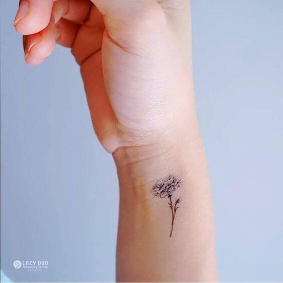 side wrist carnation January flower tattoo design