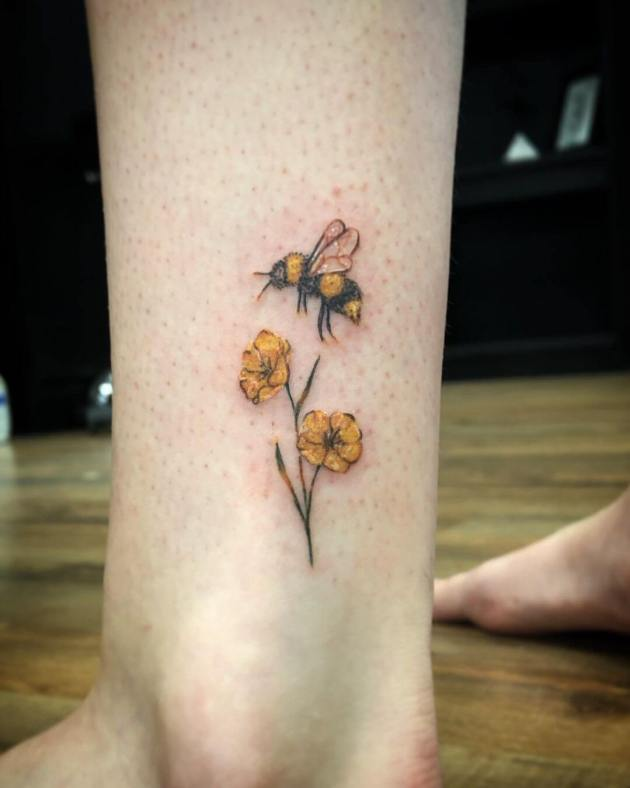 fuzzy bumblebee and primrose tattoo design on ankle