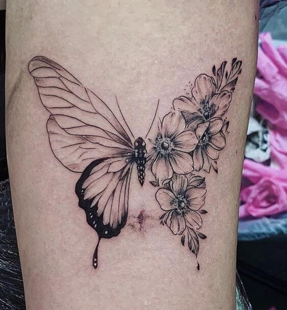 beautiful black and white butterfly with narcissus flowers tattoo design