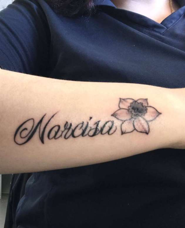 narcissus flower tattoo on side arm