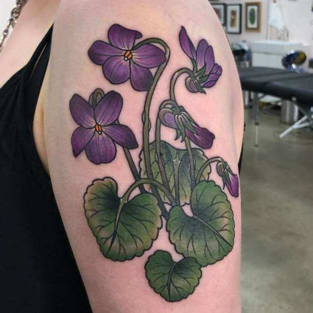 violet flowers with leaves tattoo design on upper arm