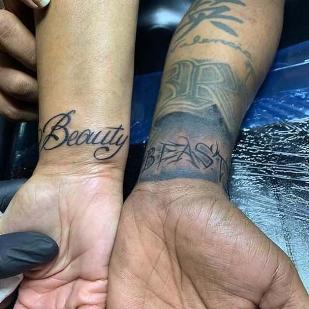 black couple beauty and the beast tattoo on wrist