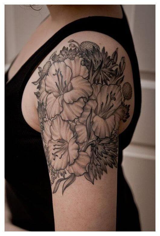 black and grey gladiolus flowers tattoo design on shoulder