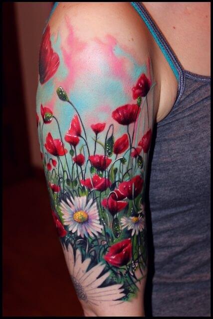 august birth poppy flowers field tattoo design on upper sleeve for females