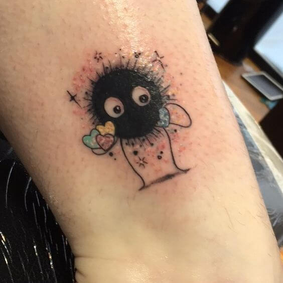 soot sprite holding tiny colorful hearts tattoo design
