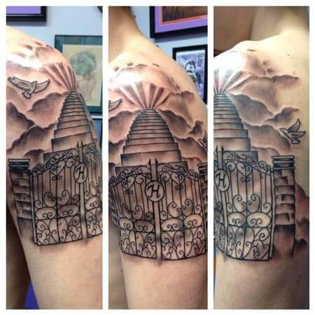 gate to heaven with staircase tattoo design on shoulder for men