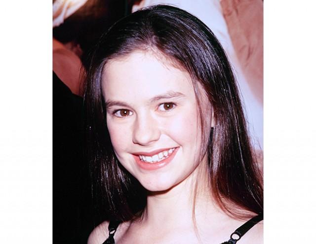 Anna Paquin, foto de infancia uno en Byrdie.com.au