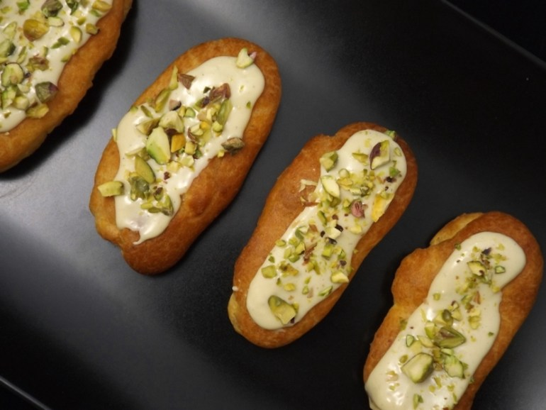 cardamom, white chocolate and pistachio éclairs