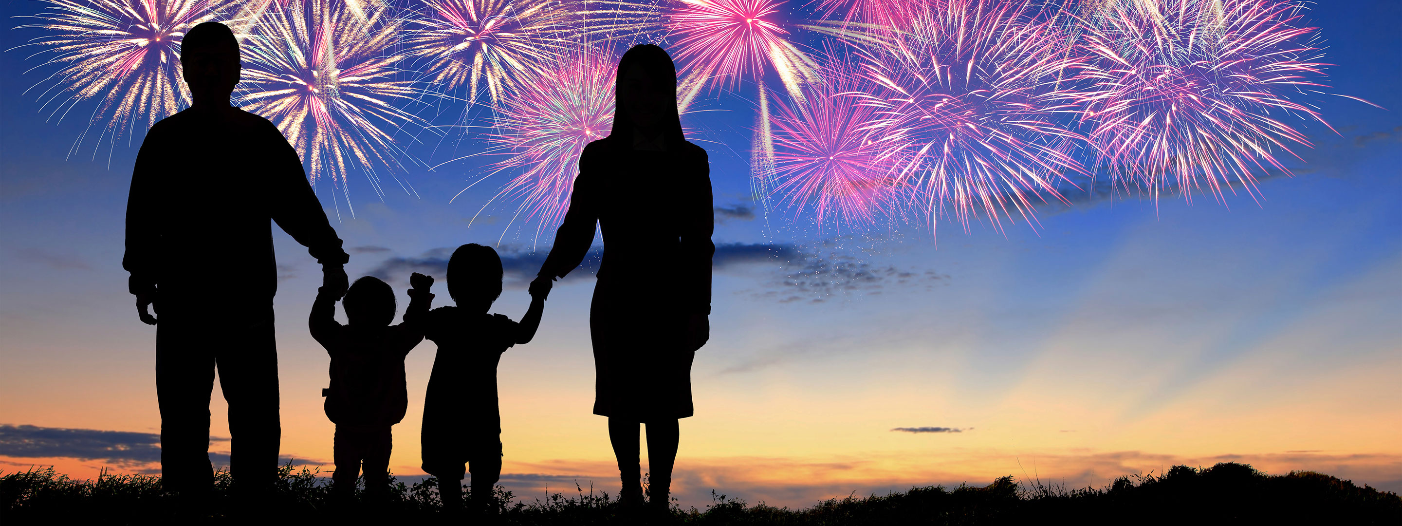Family protecting their hearing during 4th of july fireworks