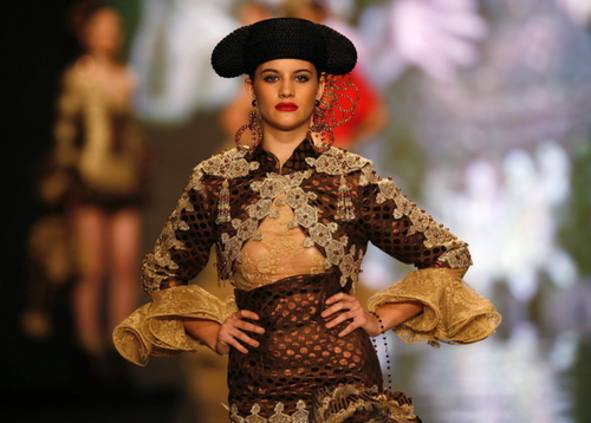 A model presents a creation from Francois Di Guardia during the International Flamenco Fashion Show in Seville