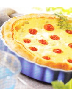 Quiche de ajos tiernos, tomatitos, apio y queso fresco al eneldo