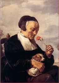 """David Teniers (1610-1690): """"Anciana oliendo un clavel"""". Una escena amable de la vida cotidiana es retomada por el artista, quien inmortaliza los actos menudos con gran riqueza de color, emoción y poesía, poniendo el frescor de una técnica de sorprendente virtuosismo."""