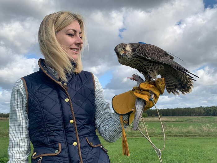 Woman holding falcon.