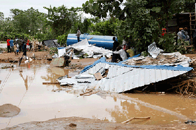 Homes left in ruins after a rainstorm.