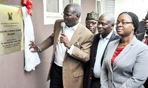 Governor Babatunde Fashola of Lagos State (left) inaugurating a health facility
